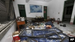 A damaged room in a residential building is seen after several locations were targeted with parcel bombs in Guangxi province, Sept. 30, 2015.