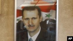 图为大马士革街头的叙利亚总统照片
