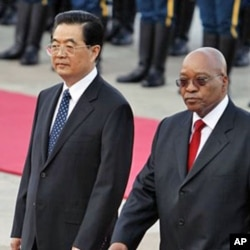 South African President Jacob Zuma, right, walks with Chinese President Hu Jintao. China has helped promote skills transfer in Africa