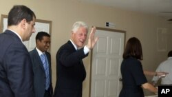 Former U.S. President and special U.N. envoy to Haiti Bill Clinton visits the Haiti Hotel School in Port-au-Prince, Monday, Sept. 17, 2012. On the same day, Clinton made a joint announcement with Qatar's ambassador that the Middle Eastern nation will give $20 million to Haiti.