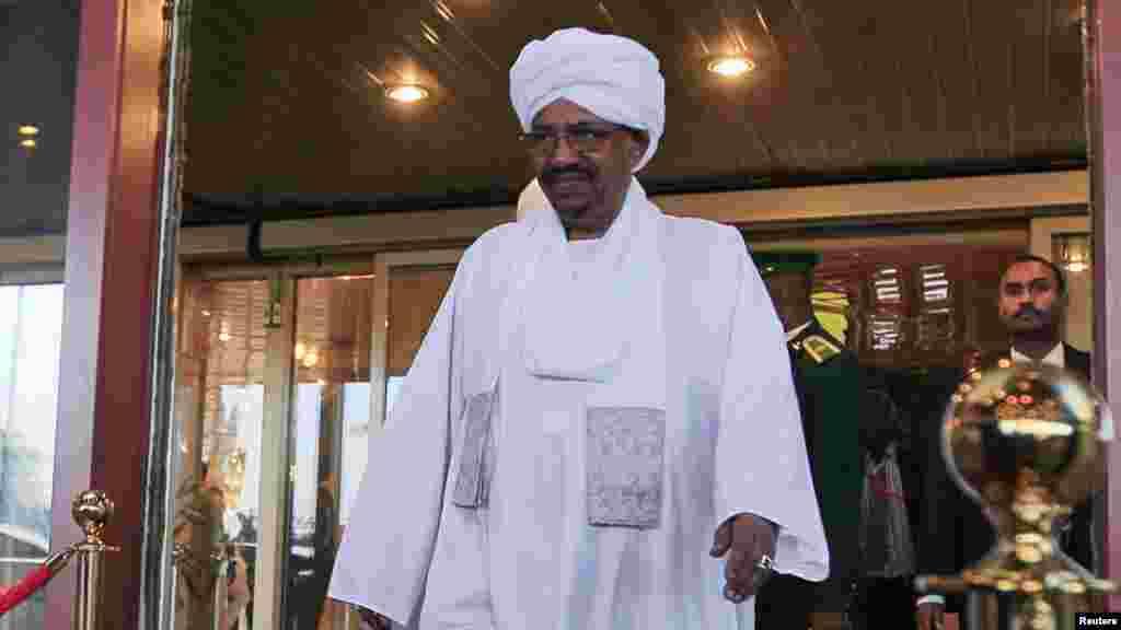 Sudanese President Omar al-Bashir walks out of a hotel in Abuja.