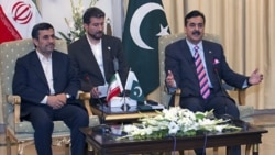 Pakistan's Prime Minister Yousuf Raza Gilani, right, with Iranian President Mahmoud Ahmadinejad at the prime minister's house in Islamabad