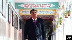 Tajik President Emomali Rakhmon arrives at a polling station in Dushanbe, Tajikistan, Sunday, May 22, 2016.