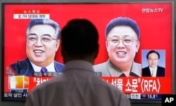 FILE - A TV screen shows pictures of North Korean leader Kim Jong Un's late father Kim Jong Il, right, and late grandfather Kim Il Sung, left, at the Seoul Railway Station in Seoul, South Korea, May 6, 2016.