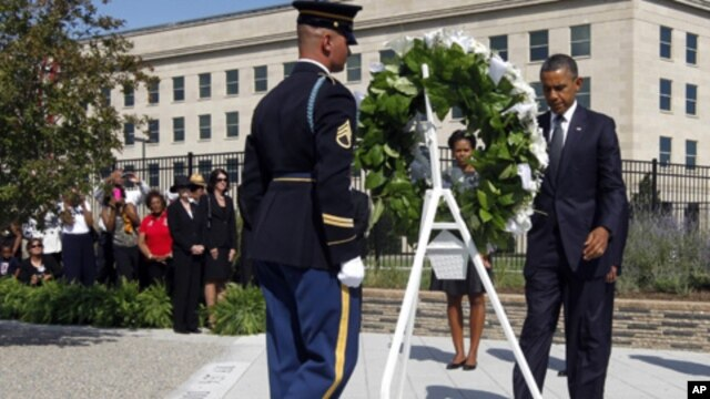 President Barack Obama and first lady Michelle Obama lay a wreath as the 10th anniversary of the Sept. 11 attacks are observed at the Pentagon in Washington, Sunday, Sept. 11, 2011.
