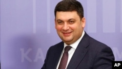 FILE - Ukrainian Prime Minister Volodymyr Groysman smiles after a press conference in Kyiv, Ukraine, Feb. 8, 2017.
