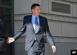 Former Trump national security adviser Michael Flynn leaves federal court in Washington, Friday, Dec. 1, 2017.