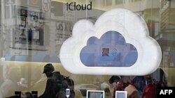 Apple products are displayed in the window of an Apple Store in San Francisco, California, January 24, 2012.