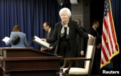 FILE - U.S. Federal Reserve Chair Janet Yellen takes her seat to conduct a press conference following the two-day Federal Open Market Committee policy meeting in Washington, March 16, 2016.