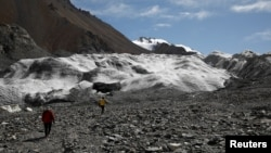 Glaciers in China's bleak, rugged Qilian mountains are disappearing at a shocking rate as global warming brings unpredictable change and raises the prospect of crippling, long-term water shortages, scientists say. (REUTERS/Carlos Garcia Rawlins)