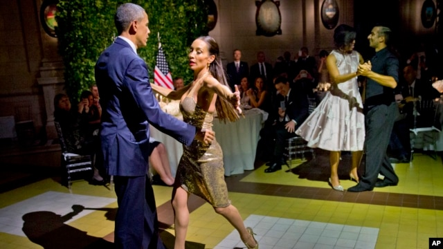 President Barack Obama and first lady Michelle Obama do the tango with dancers during a state dinner at the Centro Cultural Kirchner, March 23, 2016, in Buenos Aires, Argentina.