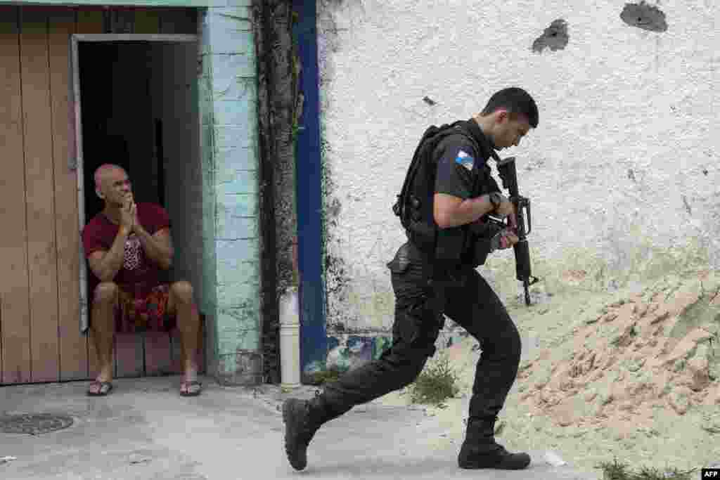 "Military police stage an operation at ""Cidade de Deus"" (City of God) favela in Rio de Janeiro, Brazil."
