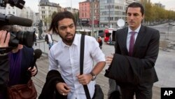 Co-defendant and key witness Jejoen Bontinck, left, arrives at the main courthouse in Antwerp, Belgium on Sept. 29. He is charged with being a member of Sharia4Belgium, which allegedly recruited fighters to go to Syria.