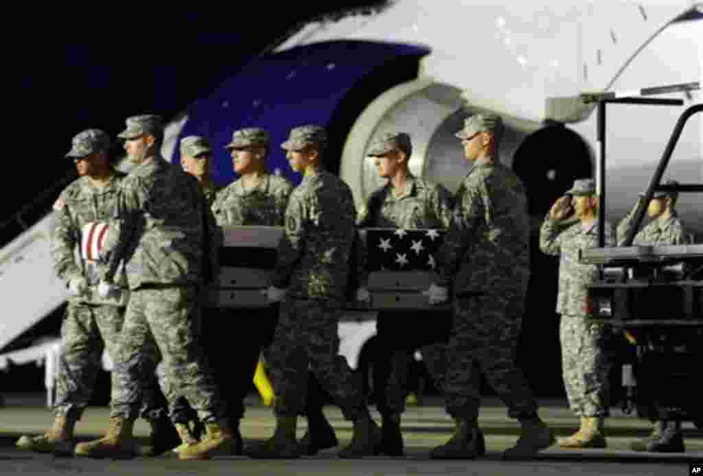 An Army carry team moves a transfer case containing the remains of Pvt. Danny Chen Wednesday, Oct. 5, 2011 at Dover Air Force Base, Delaware. (AP)