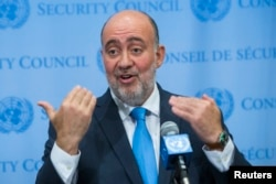 FILE - Israel's U.N. Ambassador Ron Prosor speaks to the media.