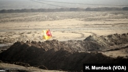 Formerly IS-controlled parts of Iraq are checkered with front lines as militants move back towards Tal Afar and Mosul, with this line marked with a Hashd Shaabi flag in the West where the pre-dominately Shia fighting force leads the charge, near Delawaya, Iraq, Dec. 17, 2016.