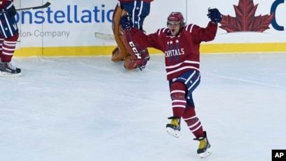 f2552e646 Washington Capitals left wing Alex Ovechkin celebrates the game-winning  goal by teammate Troy Brouwer
