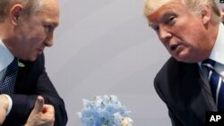 Президент США Дональд Трамп и президент России Владимир Путин. Гамбург, Германия. 7 июля 2017 г.