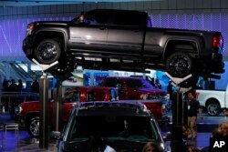 FILE - In this Tuesday, Jan. 12, 2016, file photo, a GMC Sierra 2500 Denali HD is displayed at the North American International Auto Show in Detroit. Four-door crew cab versions are built in Silao, Mexico.