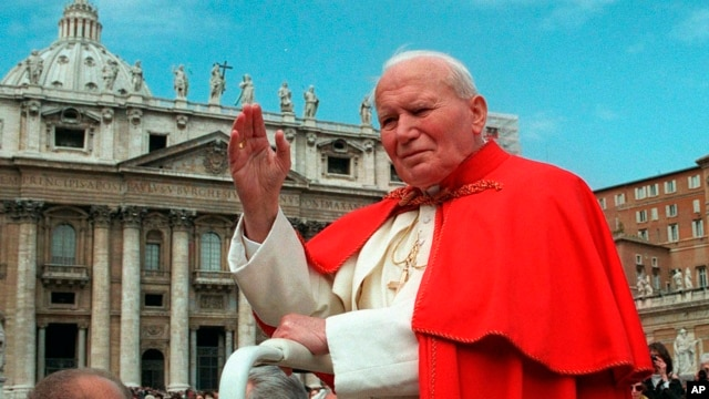 FILE - In this file photo taken on April 23 1997, Pope John Paul II waves to faithful as he crosses St. Peter's square at the Vatican.