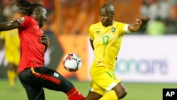 FILE: Zimbabwe's Knowledge Musona, right, and Uganda's Hassan Masanda Wasswa fight for the during the group A soccer match between Uganda and Zimbabwe at the Africa Cup of Nations at Cairo International Stadium in Cairo, Egypt, Wednesday, June 26, 2019. (AP Photo/Ariel Schalit)
