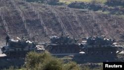 Turkish army tanks are seen near the Turkish-Syrian border in Kilis province, Turkey, Jan. 31, 2018.
