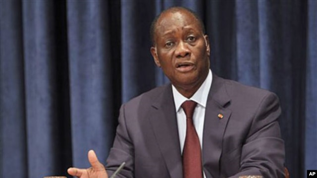 Ivory Coast President Alassane Ouattara speaks to reporters during a news conference at the United Nations headquarters in New York, July 27, 2011