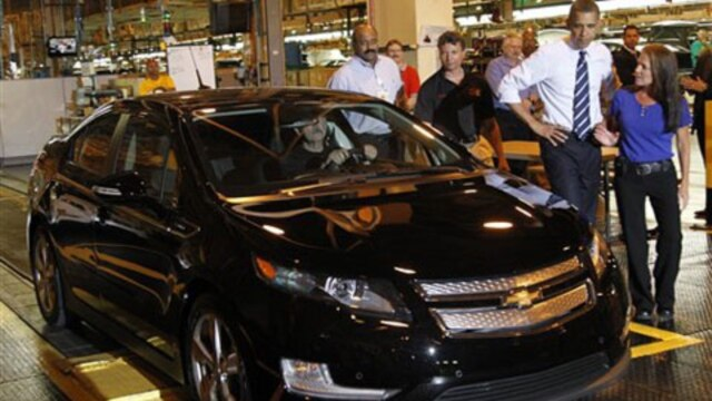 President Obama looks at a newly built Chevy Volt during a visit to a GM factory in Hamtramck, Michigan, in July