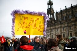 Opponents of the anti-Islam movement Pegida gather during demonstrations in Dresden, Germany, Feb. 6, 2016.