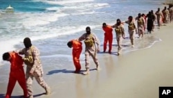 FILE - This undated image made from video released by Islamic State militants April 19, 2015, purports to show a group of captured Ethiopian Christians taken to a beach before being executed.