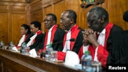 Kenya's Supreme Court judges preside before delivering a detailed ruling laying out their reasons for annulling last month's presidential election in Kenya's Supreme Court in Nairobi, Sept. 20, 2017.