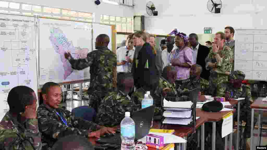U.S. Ambassador to the United Nations Samantha Power, center, visits the Western Area Emergency Response Centre in Freetown, Sierra Leone, Oct. 27, 2014.