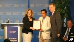Sok Khemara, VOA Khmer staff (middle) receives David Burke Distinguished Journalism Awards, an annual award presented by the Broadcasting Board of Governors.