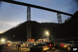 FILE - West Virginia State Police direct traffic at Massey Energy's Upper Big Branch Coal Mine in Montcoal, West Virginia, after 29 coal miners were killed in the April 2010 explosion.
