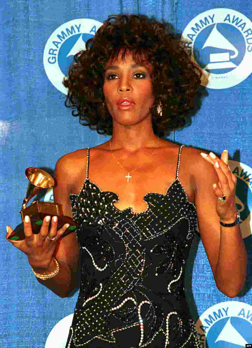 In this March 3, 1988 photo, Whitney Houston poses with her Grammy at the annual Grammy Awards presentation in New York. Houston died February 11, 2012. (AP)