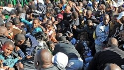 Thousands of parents and young students seeking to attend the University of Johannesburg push their way into the gates on January 10, causing a stampede. One person was killed and at least 20 injured.