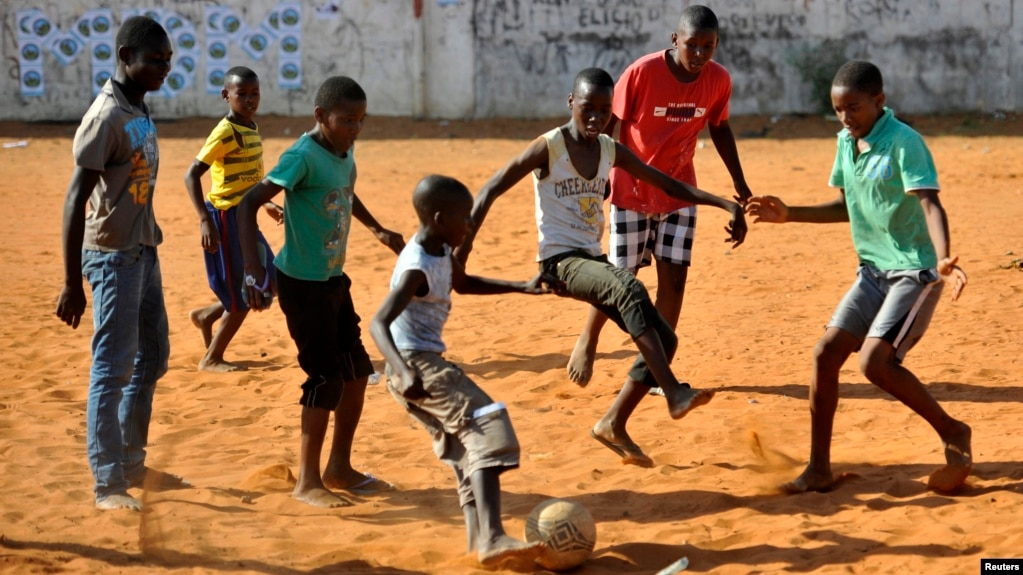 Image result for soccer with african children