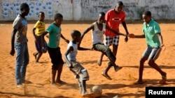 Children play soccer in Maputo, Mozambique, Nov.16, 2013.