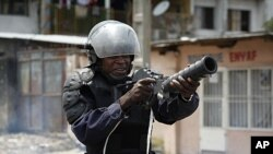 Riot policeman aims a tear gas gun in Democratic Republic of Congo's capital Kinshasa, Dec. 10, 2011.