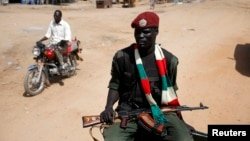 An SPLA soldier on patrol in Juba. South Sudan Interior Minister Aleu Ayienyi Aleu has ordered the security forces to shoot anyone who violates the curfew in the capital.