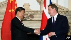 在2015年10月習近平訪英時,與時任首相卡梅倫同意了欣克利核電項目時資料照。