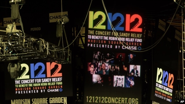 "Signage for the ""12-12-12"" concert is displayed on the Madison Square Garden jumbotron in New York, December 11, 2012."