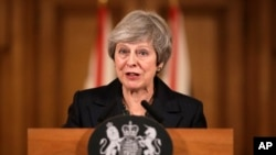 FILE - Britain's Prime Minister Theresa May speaks during a press conference inside 10 Downing Street in London, Nov. 15, 2018.