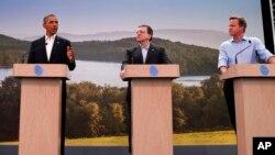 Desde la derecha, David Cameron, el presidente de la Comisión Europea, José Manuel Barroso, y el presidente Obama durante el anuncio de las negociaciones del TLC con Europa.