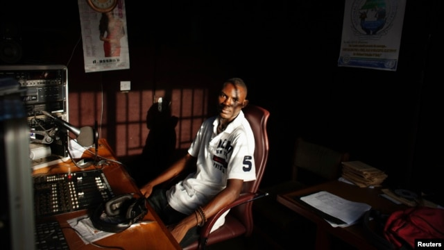 Communications student Mohamed Alpha Ba, 21, poses for a picture in the studio of the radio station he volunteers with, at Sierra Leone's prestigious Fourah Bay College in the capital Freetown, November 2012.