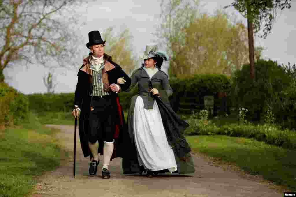 Izabela Pitcher, owner of Prior Attire, and her husband Lucas dressed in historical attire, take their daily evening walk around their Buckinghamshire village near Milton Keynes, Britain, April 13, 2020.