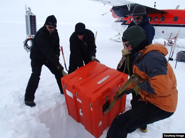 A seismic station in the process of being installed. The large orange box contains about 200 kilograms worth of batteries, electronics to that help operate the station, which will be lowered into a hole. (Credit: Lindsey Kenyon)