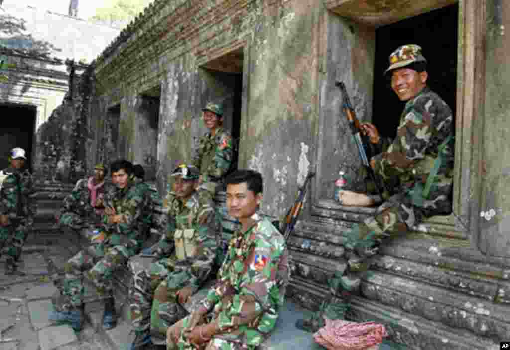 Cambodian soldiers sit at Preah Vihear temple after a brief clash with Thai troops, February 05, 2011