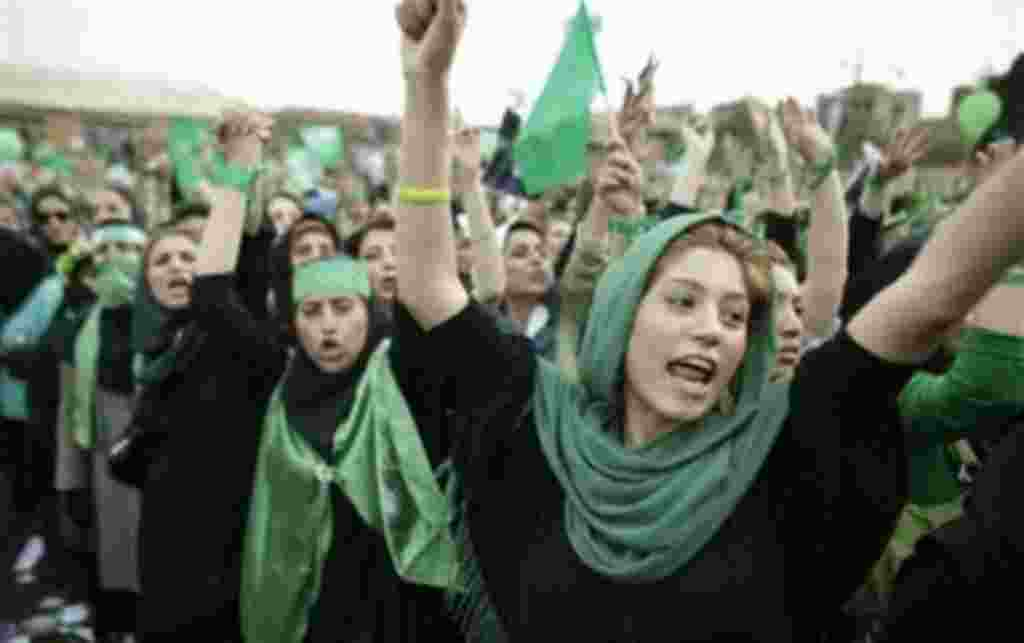 File - A supporter of main challenger and reformist candidate Mir Hossein Mousavi shouts from the crowd amidst a festive atmosphere at an election rally at the Heidarnia stadium in Tehran, Iran, in this June 9, 2009 file photo. A reader-submitted question