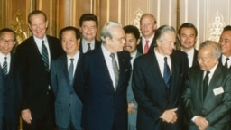 Foreign ministers attending the Paris Peace Conference on Cambodia pose prior to the meeting, Oct. 23, 1991. Front row L-R: United Nations Secretary General Javier Perez de Cuellar, Roland Dumas of France, Cambodia's Prince Norodom Sihanouk, back row L-R: